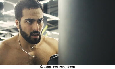 Close up Boxer Training - Bearded topless boxer have punch...
