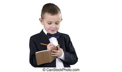 Close up. Boy in a formal clothes writing in check list or notebook on white background. Professional shot in 4K resolution. 016. You can use it e.g. in your commercial video, education, business, presentation, broadcast