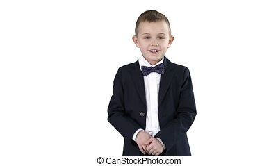 Boy in a formal suit kicking football on white background. -...