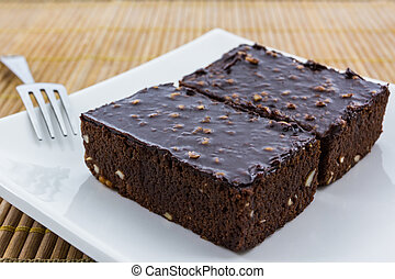 Brownie cake on white background.
