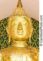 Close up Buddha image's face.
