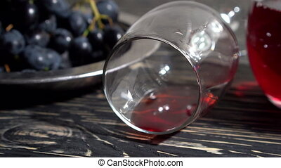 Close up bunch of Grapes , glass of red wine and bottle. -...
