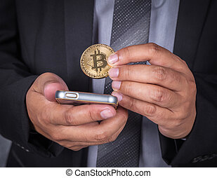 close up business man with bitcoin and using mobile phone