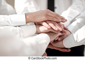 close up. business people with a stack of hands