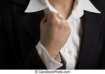 Close up business woman raised hand arm, strong gesture.