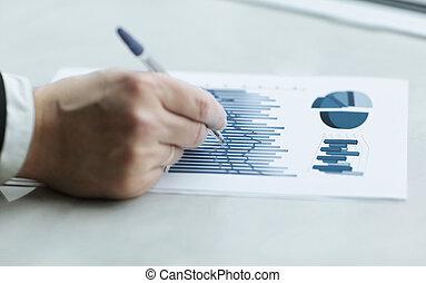 close up. businessman checking financial data. business concept