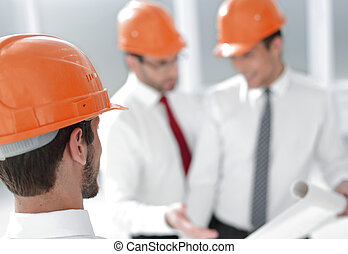 close up. businessman in hard-hat looking at his office