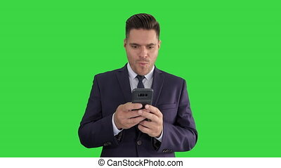 Businessman looking at smartphone with surprise expression...