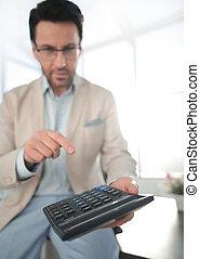 close up. businessman with calculator.