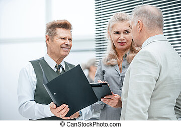 close up. businesswoman discussing work plan with her colleagues