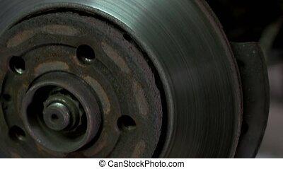 Close up car wheel hub. Detailed brake disk.