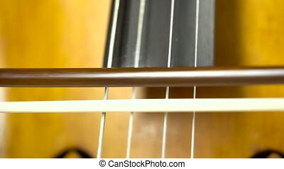 Close up cello playing - Playing the cello close up bow...
