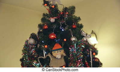 Close up Christmas Tree - Downwards, vertical pan of a fully...