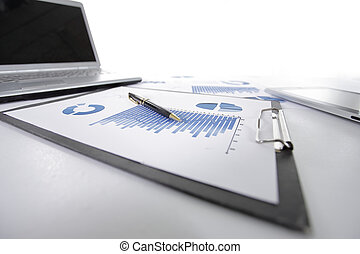 close up. clipboard with financial chart on the desktop