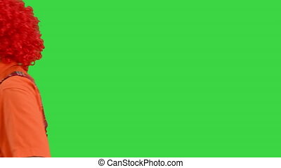 Close up. Clown walking by in a funny manner on a Green Screen, Chroma Key. Professional shot in 4K resolution. 061. You can use it e.g. in your medical, commercial video, business, presentation, broadcast