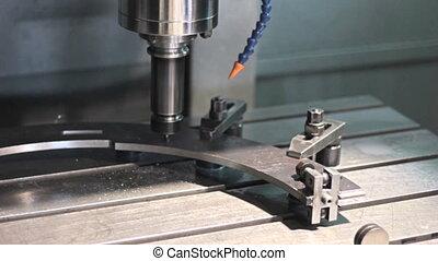 Close-up CNC  Machine milling drilling steel part.