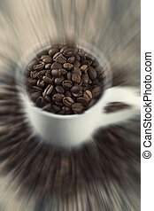 Close-up coffee beans in a cup with artistic conversion zoom warp