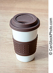 close up coffee cup on blurry wood table background