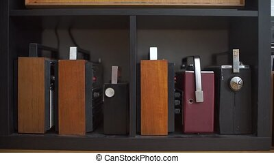 collection of old receivers that stand on a shelf