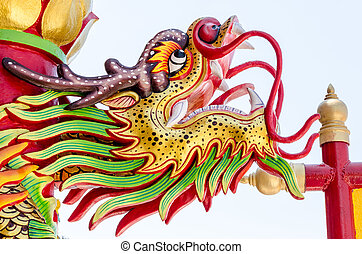 Close up colorful dragon statue. The statue of a Chinese dragon is the power.