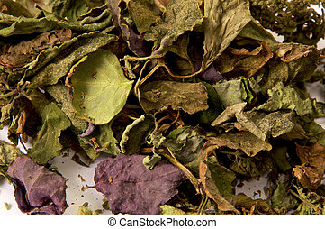 close up colorful pile of dried patchouli leaves and flowers
