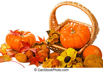 Close up composition of pumpkins, nuts and leaves on the table.