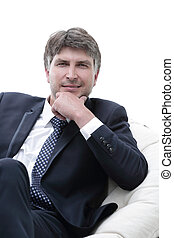 close-up. Confident businessman sitting in a chair