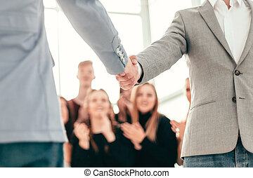 confident young business people meet each other with a handshak