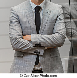 Close-up cropped Caucasian hands and arms of businessman in a suit