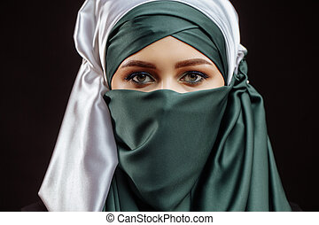 close up cropped photo of awasome Muslim girl in green hijab