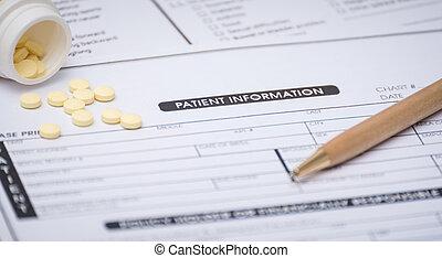 close-up, de, informação paciente, conceito, e, caneta, ligado, paciente, forma, ligado, a, desk.