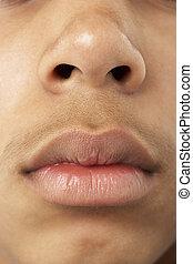 close-up, de, jovem, menino, boca, e, nariz