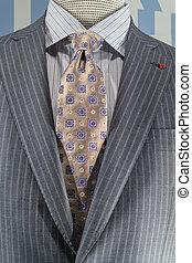 close-up, de, um, cinzento claro, listrado, casaco, com, azul, camisa listrada, e, patterned, bege, tie.