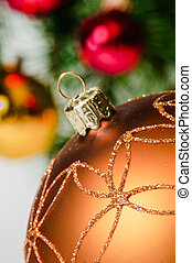 Close up decorative ball on the background of Christmas tree.
