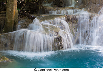 Close up deep blue stream waterfalls