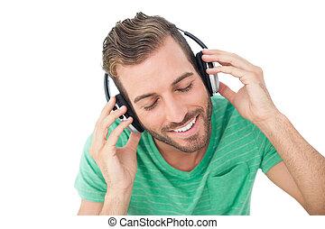 close-up, desfrutando, música, homem jovem