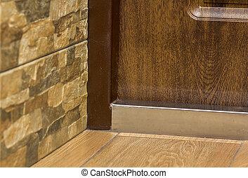 Close-up detail of brown wooden door