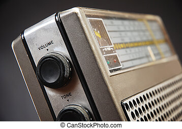 Close up detail of old radio, tone and volume knobs