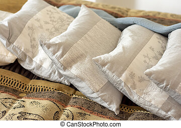 Close up detail of soft pillow on sofa in a home.
