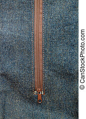 Close-up detailed jeans and brown zipper