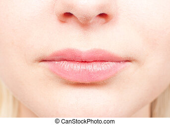 Close-up details of a woman's face - the nose and mouth