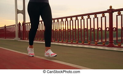 close up details runner run on the bridge - unrecognizable...