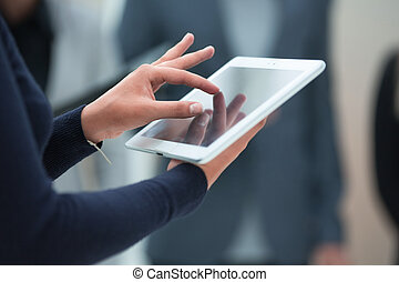 close up. digital tablet in the hands of a business woman