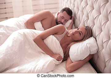 close up. dreaming young woman lying in family bed