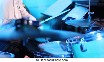 Close up Drummer Playing in disco lights