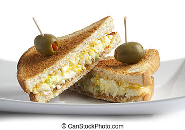 close up egg sandwich with olive fruit