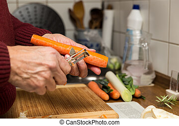 male hands peel vegetables - close up, elderly male hands...