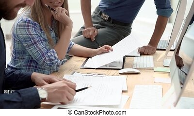 close up. employees discussing financial documents at an office meeting.
