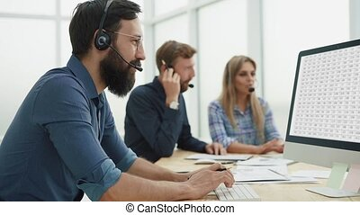 employees in the headset analyzing information coming to the office.