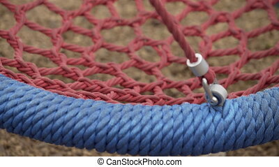 Close up Empty hanging swings at child playground loop - ...